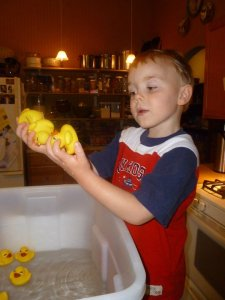 Bring bath toys in the kitchen for water play time.